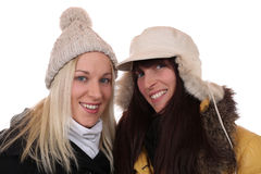 Two smiling women in winter with scarf and caps Royalty Free Stock Photos