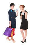 Two smiling womenwith shopping bags holding money Royalty Free Stock Images