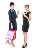 Two smiling womenwith shopping bags holding money Royalty Free Stock Photo