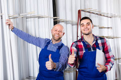 Two smiling workmen at factory Stock Photo