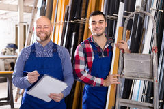 Two smiling workmen at factory Stock Images