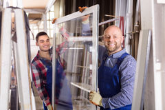 Two smiling workmen at factory Stock Photography