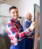 Two smiling workmen at factory Stock Photos