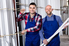 Two smiling workmen at factory Royalty Free Stock Photos