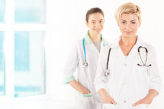 Two smiling young doctors Royalty Free Stock Photography