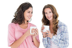 Two smiling young female friends drinking coffee Stock Image