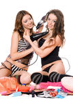 Two smiling young girlfriends with hair dryers Stock Photo