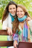 Two smiling young girls outdoors Royalty Free Stock Images