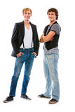 Two smiling young men with crossed arms Royalty Free Stock Images