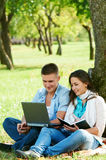 Two smiling young students outdoors Royalty Free Stock Images