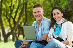 Two smiling young students outdoors Stock Photography