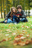 Two smiling young students outdoors Stock Photo