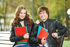 Two smiling young students studying outdoors Stock Image