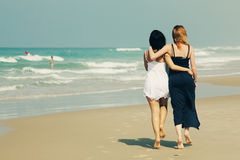 Two smiling young teenage girlfriends Stock Photo