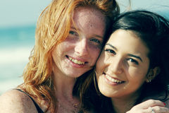 Two smiling young teenage girlfriends Stock Photos