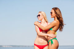 Two smiling young women on beach Stock Photo