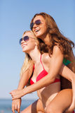 Two smiling young women on beach Royalty Free Stock Photography
