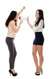 Two smiling young women crying in megaphone Royalty Free Stock Image
