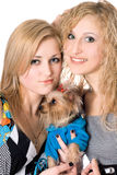 Two smiling young women with dog Royalty Free Stock Photo