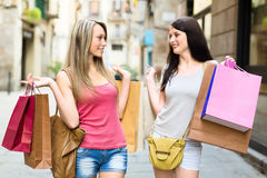 Two smiling young women doing shopping Royalty Free Stock Photo