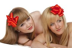 Two smiling young women with gift red bow Stock Image