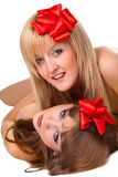Two smiling young women with gift red bow Stock Images
