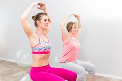 Two woman performing yoga exercise stock photography