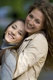 Two smilling girlfriends. On street Stock Image