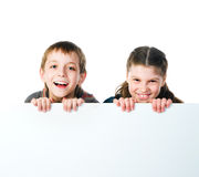 Two smily kids. Isolated over white background Royalty Free Stock Image