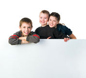Two smily kids. Isolated over white background Stock Images
