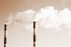Two smoke stacks Royalty Free Stock Photography