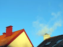 Two smokestack on roofs Stock Photo