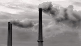 Two Smokestacks Billowing Clouds Of Fumes Stock Images