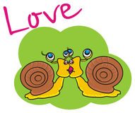 Two snails and inscription love Royalty Free Stock Photography