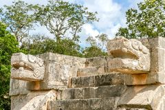 Two snake heads at Chichen Itza. Rich Maya culture can be observed at Chichen Itza, Mexico. Each wall tells us the story and the past of this civilization Stock Image