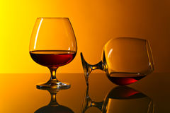 Two snifters of brandy on glass table Royalty Free Stock Image