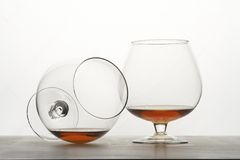 Two snifters of cognac on table. Stock Photos