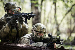 Two snipers on military operation. In woods during day royalty free stock photography