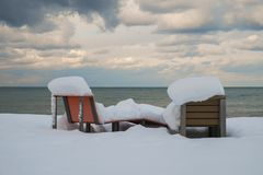 Two snow covered benches Stock Photos