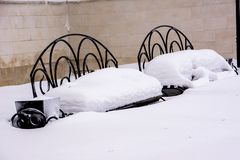 Two snow-covered benches royalty free stock photography