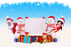 Two snow man holding sign with santa Stock Photography