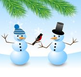 Two snow men with a bird bullfinch Stock Photo