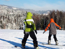 Two snowboard begginers Stock Image