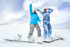 Two snowboard rider girls Stock Photography
