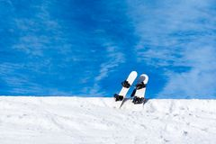 Two snowboard in snow mountain slope. Winter background Stock Photography