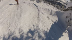 Two snowboarders crash into each other while. Two boya have fun riding the snowboard stock video