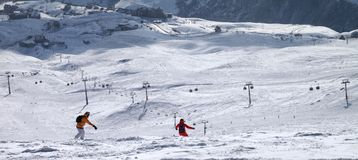 Two snowboarders downhill on freeride trace Stock Images