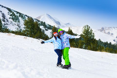 Two snowboarders standing close to each other Royalty Free Stock Images