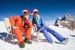 Two snowboarders on top of the mountain having fun Royalty Free Stock Images