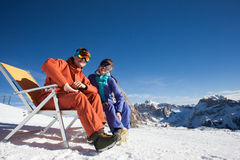 Two snowboarders on top of the mountain having fun Royalty Free Stock Image